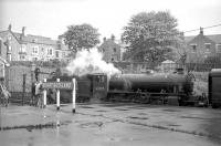 K1 2-6-0 no 62005 stops to take on water at Bishop Auckland on 20 May 1967 on the way back from Westgate with the SLS <I>Three Dales Railtour</I> returning to Middlesbrough.<br> <br><br>[Robin Barbour Collection (Courtesy Bruce McCartney) 20/05/1967]