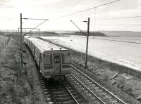 Prototype EMU 920001 approaching Ardmore West level crossing on a test run returning from Helensburgh around 1977.<br><br>[Gordon Smith Collection (Courtesy Ken Browne)&nbsp;//1977]