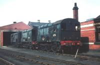 A trio of class 08 shunting locomotives stabled on Eastfield shed in May 1959. This was BRs most numerous locomotive class with 996 units being built between 1953 and 1962. The only identifiable example in this photograph, nearest the camera, is D3396. This became 08326 on renumbering and was eventually withdrawn by BR in October of 1983.<br><br>[A Snapper (Courtesy Bruce McCartney)&nbsp;23/05/1959]