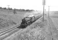 A Glasgow Fair Saturday southbound extra headed by Black 5 no 45455 off 12A Kingmoor shed, photographed near Braidwood on the WCML in July 1966.<br> <br><br>[Colin Miller&nbsp;/07/1966]
