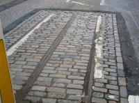 The remnants of Edinburgh's cable-car system in Waterloo Place, looking east on 17 November 2009. Notice the central slotted rail within which the cable ran. Edinburgh's first cable hauled 'tramcar' ran in 1888 with the system operating for 35 years until eventually being converted to electric traction (which had been employed by Leith Corporation to operate its trams since 1905). [See image 26669]<br> <br><br>[John Furnevel&nbsp;17/11/2009]