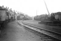 Locomotive sidings at Corkerhill shed, seen looking west in July 1966. On the left stands part of the original <I>Corkerhill Railway Village</I> [see image 19972] on which demolition commenced in 1969. Locomotives on show include Standard, Black 5 and diesel types.<br><br>[Colin Miller&nbsp;/07/1966]