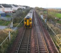 A Waverley - Glasgow Central service heads west towards Kirknewton station on 27 November 2009. The DMU is passing the site of Camps Junction [see image 25874]. Nothing remains of the foot crossing or signal box that stood here, other than perhaps some charred wooden remains alongside the line on the right.   <br><br>[John Furnevel&nbsp;27/11/2009]