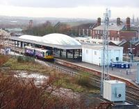 A Northern Pacer calls at Blackburn's rebuilt station on its way to Colne. To the right, partly obscured by the telephone mast, the original station entrance building is still in use but the huge trainshed that once spanned the platforms [See image 7725] is now demolished.<br><br>[Mark Bartlett&nbsp;04/12/2009]