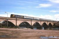 A train from the north slows across the old Ness Bridge in Inverness in 1977.<br><br>[Frank Spaven Collection (Courtesy David Spaven)&nbsp;//1977]