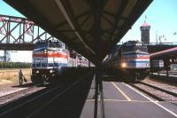 A snapshot in Amtrak history at Union Station, Portland, Oregon, in the summer of 1994. On the left is the <I>Coast Starlight</I> service from Los Angeles to Seattle, while to the right is the Chicago-Denver-Seattle <I>Pioneer</I>. The latter had a relatively short operating life, from 1977 to 1997, but intermediate communities which lost their only passenger train service - such as Laramie, Boise and Baker City - have recently been campaigning for service reinstatement.<br><br>[David Spaven&nbsp;//1994]