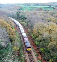 The morning Goonbarrow Junction to Fowey loaded China Clay train heads south from Luxulyan. The view is from Treffy's viaduct and the train is on a 'new' section of line which replaced a nearby incline and, sadly, Treffy's Viaduct.<br><br>[Ewan Crawford&nbsp;18/11/2009]