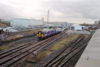 Blackburn, as seen looking west from the adjacent supermarket car park, showing 158842 pulling into Platform 3 on a York to Blackpool service. The one remaining through goods line is to the left of the train and on the far right the four chimneys of the original station building can be seen, still partly in railway use but mainly now the town centre police station. <br><br>[Mark Bartlett&nbsp;04/12/2009]