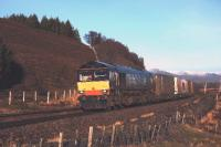 With snow on the hills, on a chilly but sunny winters day, DRS 66423 is pictured heading south from Dalwhinnie with the J G Russell container train.<br><br>[John Gray&nbsp;11/12/2009]