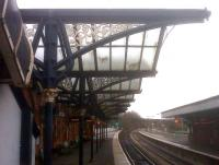 Awnings on platform 1 at Wellingborough in December 2009 - dirty, but unbowed. View looks North.<br><br>[Ken Strachan&nbsp;09/12/2009]