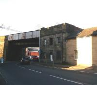 Incle Street, Paisley, just to the east of Gilmour Street station, photographed in November 2009. The squareish building was, for many years, known as <I>The Tabernacle</I> - presumably a religious hall - but also the base of Wallneuk Junction Signal Box. The hall was there when the box was operational - which must have been a bit noisy with the lever frame active and trains passing above.<br><br>[Colin Miller&nbsp;30/11/2009]
