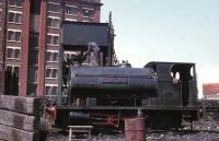 Peckett 0-4-0ST <I>Victoria</I>, built as 2028/1942 for the Royal Ordnance Factory at Sellafield, is seen here being watered outside the Quaker Oats building at Whitehaven Harbour in 1968. It worked here for a further three years. <br><br>[David Hindle&nbsp;//1968]