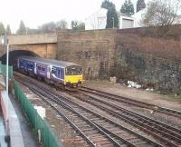 A Clitheroe to Manchester service emerges from the west end of Blackburn tunnel and runs into the station. The area in front of the two retaining walls was occupied by Blackburn East signal box until 1972, since when the track layout has been simplified and the tunnel lines are now bi-directional.<br><br>[Mark Bartlett&nbsp;04/12/2009]