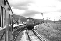 In the summer of 1969 a Cambrian Coast freight for Aberystwyth passes Dovey Junction as passengers for Shrewsbury await the arrival of an eastbound DMU.<br><br>[David Spaven&nbsp;//1969]