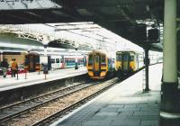 158s at platforms 5 and 6S at Aberdeen station await their departure times with southbound services on 17 July 1999, while 156 478 is about to leave platform 7S and head for Inverness.<br><br>[David Panton&nbsp;17/07/1999]
