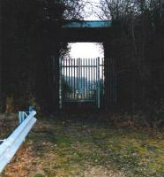 Not as it seems, part 1 - a tall and secure gate and fence like this are not what the dedicated railway walker wants to see - in this case, on Birch Coppice #4 pit line (see images 25983 and 25985). However, the former 'main line' from the MR at Kingsbury to Baxterley passes overhead. By scrambling up the embankment and down again, one can rejoin the trackbed on the far side of the fence. Our exploration of this line was fitted in after buying a plumbing fitting in the industrial estate adjacent to the freight terminal built on the site of Birch Coppice (#1) pit. We were quizzed by Security, but allowed to continue!<br><br>[Ken Strachan 18/03/2009]