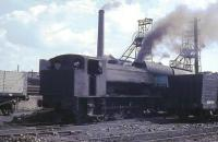 Flanked on either side by wooden bodied coal wagons, and with the two pit head winding gear towers behind, 0-6-0ST <I>Revenge</I> makes a fine site as it shunts steel hopper wagons at Haig Colliery. Although steam working finished soon after this the pit itself survived until 1986 becoming Cumbria's last deep mine and is now partly preserved, including one of the headgears. <br><br>[David Hindle&nbsp;//1968]
