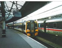 Platform 5 at Aberdeen on 12 October 1998 and the driver of 148 703 is in his cab to take the train south, though the LCD destination blind is yet to be changed from Aberdeen.� Although well into privatisation both this set and the sleeper stock next to it are still in BR era livery. The InterCity brand, though defunct here, was picked up by other countries, including, untranslated, Germany.<br> <br><br>[David Panton&nbsp;12/10/1998]