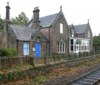 The impressive former station building at Beauly seen from the current mini-platform on 3 October 2009 looking towards Inverness. Nowadays the building is in use as a combination of office and residential accommodation.<br><br>[John Furnevel&nbsp;03/10/2009]
