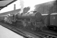 Rebuilt <I>Patriot</I> 4-6-0 no 45545 <I>Planet</I> stands in the sidings on the west side of Carlisle station in the early 1960s at the head of a northbound parcels train.<br><br>[Robin Barbour Collection (Courtesy Bruce McCartney)&nbsp;//]
