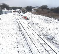 A snowy view of the new run-round loop on the old Dalry line, looking west from Bridge 102, with the track gang applying the finishing touches to the buffer stop at the end of the line. <br> <br> <br><br>[Robert Blane&nbsp;20/12/2009]