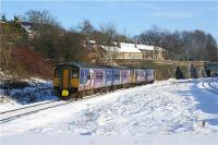 The 1045 hrs Northern Trains Manchester to Sheffield service has just called at Chinley on 23 December 2009. The Class 142 and 150 combination are seen heading eastwards, away from the camera in winter sunshine and with a blanket of snow on the ground. Merry Christmas<br><br>[John McIntyre&nbsp;23/12/2009]