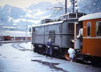 Snow-capped mountains form the backdrop at Myrdal, Norway, in 1967 as the crew prepares to uncouple the locomotive that has hauled the train up from Flam.<br> <br><br>[Colin Miller&nbsp;/07/1967]