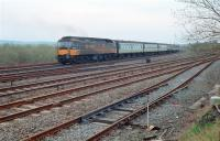 A class 47 propels a train onto the Scottish Central Railway at Greenhill Upper Junction in 1988. The view looks east with the E&G in the foreground.<br><br>[Ewan Crawford&nbsp;//1988]