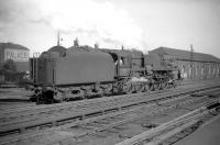 Crosti-boilered 9F 2-10-0 no 92024 at the south end of Carlisle station in July 1959. The 9F was one of 3 of this type transferred to Kingmoor shed for a time. [See image 34814]<br><br>[Robin Barbour Collection (Courtesy Bruce McCartney)&nbsp;04/07/1959]