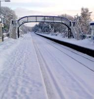View south from Carrbridge station on 27 December 2009, with the 'signs of life' having been left by a passing class 37 on snow clearance duty.   <br><br>[Gus Carnegie 27/12/2009]