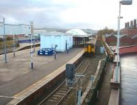 Clitheroe bound trains usually use the loop (Platform 1) at Blackburn while trains for York or Colne use platform 2. 150205 pulls away from Blackburn heading for the Ribble Valley and Clitheroe in this view looking west from the multistorey supermarket that occupies the old fish and parcels depot site. There is a marked contrast between the surviving station entrance building on the right and the rebuilt platform structures.<br><br>[Mark Bartlett&nbsp;04/12/2009]
