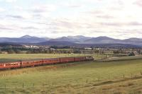 With the Cairngorms forming the horizon, a Birmingham type 2 draws a southbound train into Broomhill station in 1961. Broomhill (now a station on the Strathspey Railway) is on the original Highland Railway route from Inverness to Aviemore via Forres and Grantown-on-Spey. [see image 34953]<br><br>[Peter Oliver Collection (Courtesy David Spaven)&nbsp;//1961]