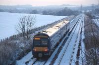 <I>Cold?   Perish the.. th.. th.. thought! </I> 170 396 coasts downhill towards Inverkeithing station on 28 December 2009  heading for Waverley with the 16.18 ex-Glenrothes with Thornton<br> <br><br>[Bill Roberton&nbsp;28/12/2009]