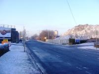 Looking along Dalmarnock Road on a cold December afternoon. The mound on the right is all that remains of the arches that carried the Switchback line. <br><br>[Colin Harkins&nbsp;28/12/2009]
