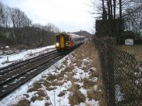 A westbound East Midlands Trains Class 158 passes Buxworth on 29 December 2009 with a service to Manchester. The westbound platform and station building still exist, although the platform is overgrown and fenced off. This was formerly a 4 track section between New Mills South Junction and Chinley North Junction, the other two tracks being on the left of the existing lines. I can confirm that it was much colder than it looks with a very strong easterly  wind blowing at ten past three on a late December afternoon!<br><br>[John McIntyre 29/12/2009]