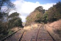Not the most well-known of railway locations, partly due to its military associations - Braeside Junction on the Charlestown branch, looking north towards the RNAD terminus at Crombie (the left-hand line) and Elbowend Junction (the right-hand line) on the Dunfermline-Kincardine line. The branch headshunt and buffer stops are behind the photographer. This is 1998, by which time all the permanent way seen here had been mothballed for a number of years.<br><br>[David Spaven&nbsp;//1998]