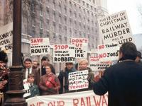 Scene of a demonstration in Whitehall, SW1, on 18 December 1968, with the Waverley petition party on the march. A young looking David Steel is standing alongside Madge Elliot, with an even younger looking Bruce McCartney holding the placard demanding <I>STOP THE GREAT TRAIN ROBBERY</I>.
