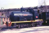 A close up of<I> Lancaster</I>, one of two fireless locos that shunted coal wagons at the power station until it closed in 1981. On the left behind the buildings a footbridge spans the former mainline in front of the canal aqueduct. For the same view more than 40 years on [see image 27041]. <br><br>[David Hindle&nbsp;//1968]