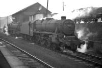 Black 5 no 45367 moves away from the coaling stage at Dalry Road shed in 1961. The photograph, taken from the adjacent platform at Dalry Road station, looking towards the Caledonian Princes Street terminus, shows how cramped the facilities were at this depot. Dalry Road shed (64C) was officially closed on 3 October 1965 and the area now forms part of Edinburgh's Western Approach Road.<br><br>[Frank Spaven Collection (Courtesy David Spaven)&nbsp;//1961]