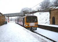Wintry conditions as Northern Pacer 144011 arrives in Platform 5 at Lancaster prior to reversing for Morecambe. Despite the falling snow, which continued to affect public transport across Britain, this service, which had travelled via Skipton and Bentham, was only running around 20 minutes late. <br><br>[Mark Bartlett&nbsp;05/01/2010]