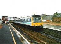 In their last months of service 117s were used to form specials from <br> Edinburgh for the Open Golf at Carnoustie in 1999.� Here on 17 <br> July an ECS set returns to the main line from the siding where it <br> allowed a train to pass.� It then changed ends, moved to the up line and returned in the direction of Dundee.<br> <br><br>[David Panton&nbsp;17/07/1999]