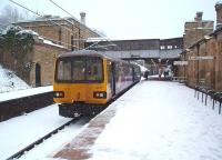 Having connected with southbound WCML trains on the opposite side of Lancaster's island platform 144011 is ready to continue its journey from Leeds to Morecambe. The snow ceased soon afterwards and compared to many other areas Lancaster <I>got off lightly</I>. <br><br>[Mark Bartlett&nbsp;05/01/2010]