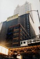 'Midland Hotel' may sound familiar, but perhaps not in this context. The Chicago Elevated Railway (The 'El'), with a train seen crossing in front of the hotel, has been used in several films, including 'The Fugitive' and is the third busiest mass transit system in the USA. The system carried 162 million passengers in 2006. The Central Loop is particularly dramatic.<br><br>[Ken Strachan&nbsp;14/09/2001]
