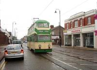 When current plans come to fruition Fleetwood will be served by new articulated light rail vehicles on all regular services. Blackpool's historic trams, such as restored 717 seen here entering Lord Street, will usually be confined to the central part of the system in Blackpool itself.  The former Woolworths store, now empty, fronts onto the street at this point. <br><br>[Mark Bartlett&nbsp;06/10/2009]