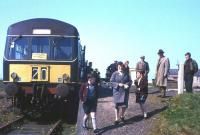 The 2.15 pm from Fraserburgh to St Combs has just arrived at the light railway's terminus on Saturday 1st May 1965, the last day of operation. The photographer's father-in-law and son (who would rather be at a football match) watch proceedings on the right. <br><br>[Frank Spaven Collection (Courtesy David Spaven)&nbsp;01/05/1965]