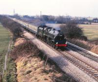 Preserved BR standard class 4 4-6-0 no 75069 with <i>The Red Dragon</i> special on 2 March 1985. The train is seen heading south through Sparcells on the outskirts of Swindon on the Gloucester line.<br><br>[Peter Todd&nbsp;02/03/1985]