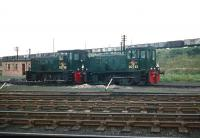 A pair of NBL diesel-hydraulic shunters nos D2728 and D2722 standing idle at the St Margarets outpost of Leith South in 1958. The mineral wagons in the background are on the embankment that carried the former Caledonian route from the eastern docks up to the bridge over Seafield Road.  <br><br>[A Snapper (Courtesy Bruce McCartney)&nbsp;//1958]