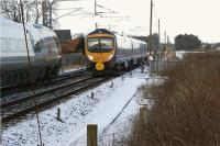 A southbound FTPE Class 185 bound for Manchester Airport passes a northbound Pendolino for Glasgow Central at the site of the former Brock station on 10 January 2010.<br><br>[John McIntyre&nbsp;10/01/2010]