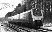 With the loss of the sun for the day, the camera was switched to Black & White mode to capture a Virgin Voyager southbound approaching Brock with a service to Birmingham New Street on a cold 10 January 2010 made even colder with a strong north easterly wind.<br><br>[John McIntyre&nbsp;10/01/2010]