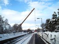 Platform scene at Carrbridge station on 11 January with container recovery ongoing.<br><br>[Gus Carnegie 11/01/2010]